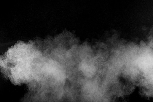 Abstract white powder explosion against black background.abstract white dust exhale. Premium Photo